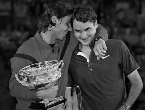 Spain's Rafael Nadal (L) puts his arm around Switzerland's Roger Federer, as he poses with his trophy, after their men's singles final match at the Australian Open tennis tournament in Melbourne February 1, 2009. REUTERS/Tim Wimborne (AUSTRALIA)